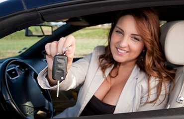 Woman handing over keys for Diamond Parking Meet and Greet Parking for Bristol Airport